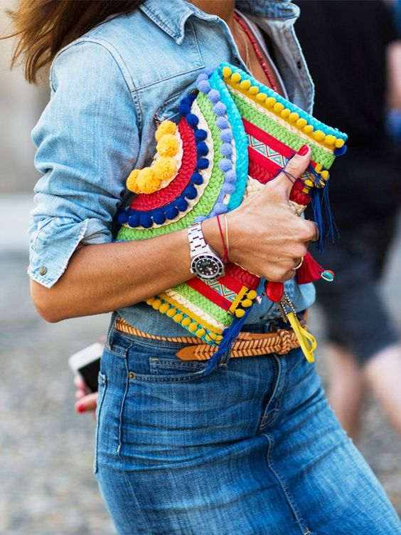 a colorful pompom clutch can be DIYed