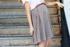 13 a grey pleated knee skirt, a black shirt and brown booties