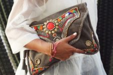 13 a large brown leather clutch with colorful beads and rhinestones for a boho look