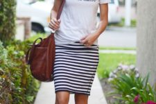 13 a printed tee, a striped black and white knee skirt, silver and animal print sandals and a large leather bag