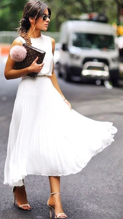 an all-white look, a sleeveless white top, a pleated white midi and nude sandals