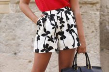 13 black and white floral print high waist shorts, a red sleeveless top and a black bag