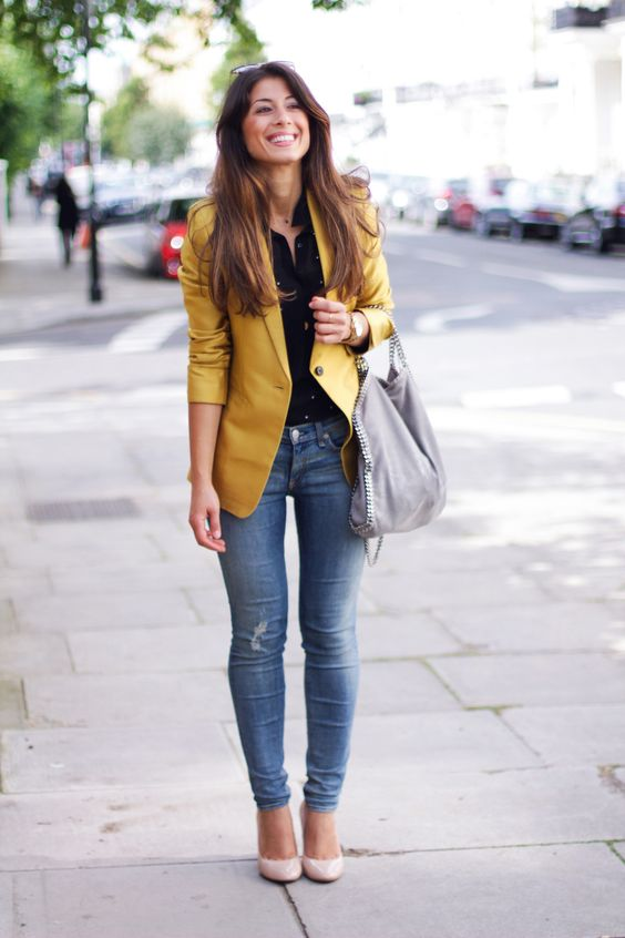 distressed jeans, a black shirt, a mustard blazer and nude shoes for a bold look