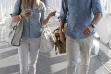 13 white pants, a chambray shirt, white sneakers and a bag