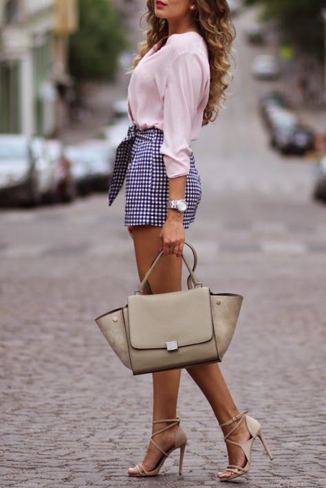 a blush shirt and plaid navy and blush shorts, nude strappy heels and a bag