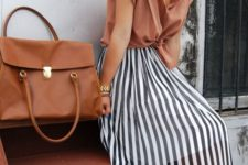 14 a burnt orange shirt with short sleeves, a black and white striped midi skirt and brown heels