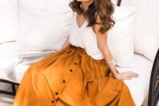 14 a mustard midi skirt with a button row, snake print shoes and a white top
