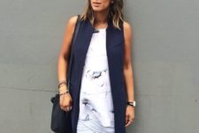 14 a printed top, a wrap skirt and a long navy vest can even hide your bump if you need