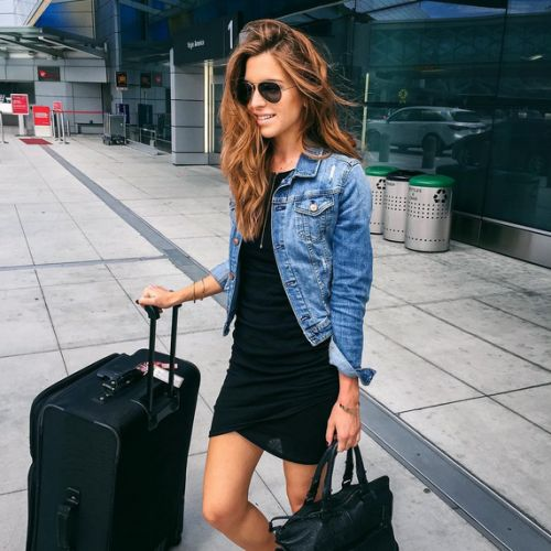 a simple black mini dress and a denim jacket with some sneakers are right what you need