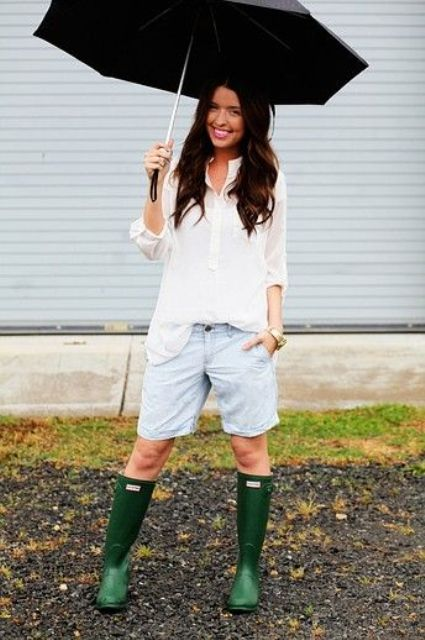 a white shirt, blue denim shorts and green rain boots for a simple and casual rain day look