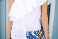 14 an embroidered blue clutch with bold gem decorations makes a colorful statement for a simple outfit