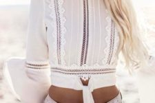 14 distressed denim mini shorts and a white boho lace crop top with ties and bell sleeves