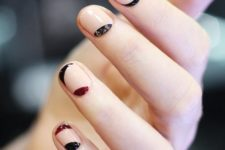 14 neutral round nails with black and red curves is a creative modern design
