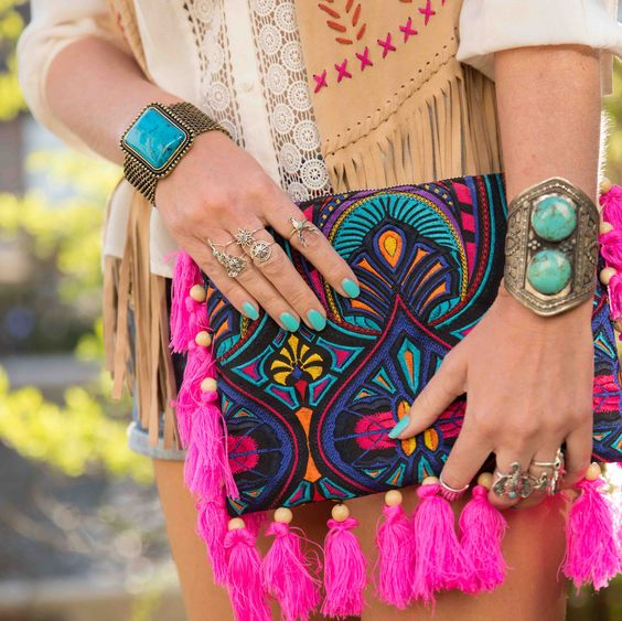 super colorful embroidered clutch with hot pink tassels