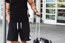 15 a black t-shirt, black Nike shorts, white sneakers and a backpack for comfy travelling