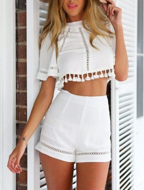 a white ctop top with boho lace and a tassel trim, high waisted shorts with lace detailing