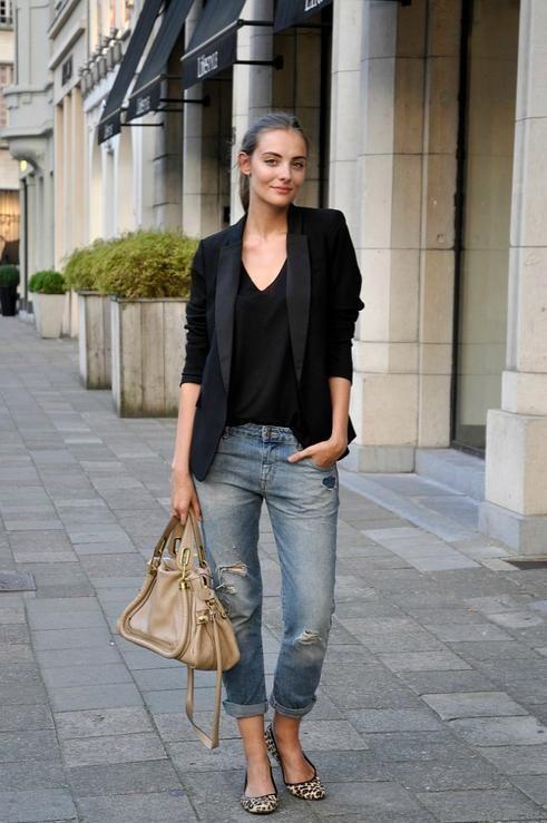 ditressed boyfriend jeans, a black top, a black blazer and leopard print flats