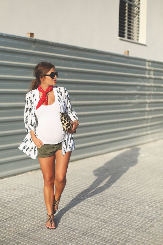 olive green shorts, a white tee, a printed blazer and chic thong sandals