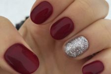 15 short rounded nails with an accent silver glitter one for winter holidays