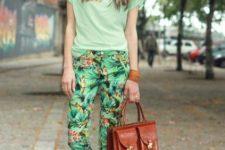 15 tropical print pants, a light gree tee, brown moccasins and a brown bag