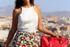 16 a white halter neckline sleeveless top, cherry printed high waisted shorts and a red bag for holidays