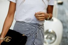 16 a white printed tee, a black and white gingham wrap mini and a clutch