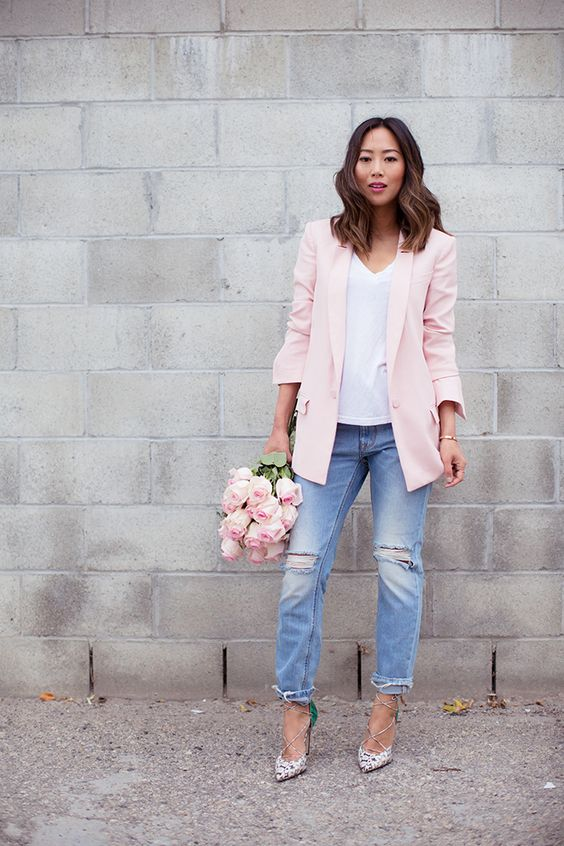distressed blue boyfriends, a white top, a pink blazer and snake print lace up shoes