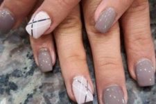 16 grey nails and striped geometric white ones for an accent