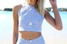 16 matching blue and white striped shorts and a crop top