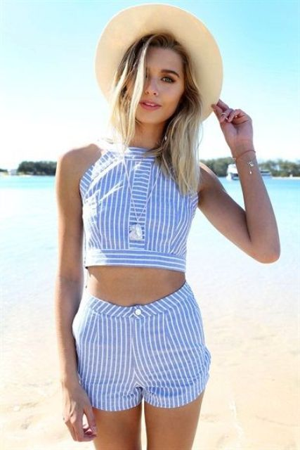 matching blue and white striped shorts and a crop top