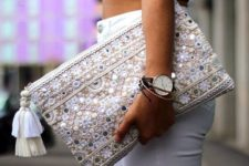 16 neutral-colored embroidered clutch with sequins and beads and a tassel