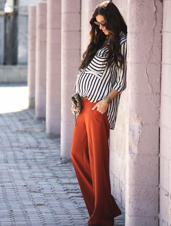 orange wide pants, a striped black and white shirt for a bold summer office look