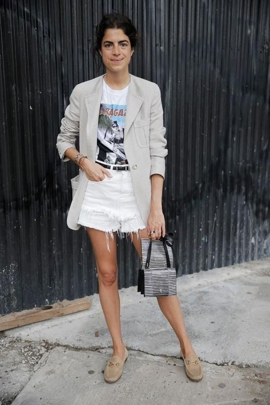 white distressed shorts, a printed tee, a neutral blazer, nude moccasins