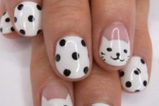 16 white with black polka dot nails and accent kitty ones