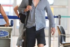17 a simple linen shirt and black shorts, a backpack by Michael Fassbender