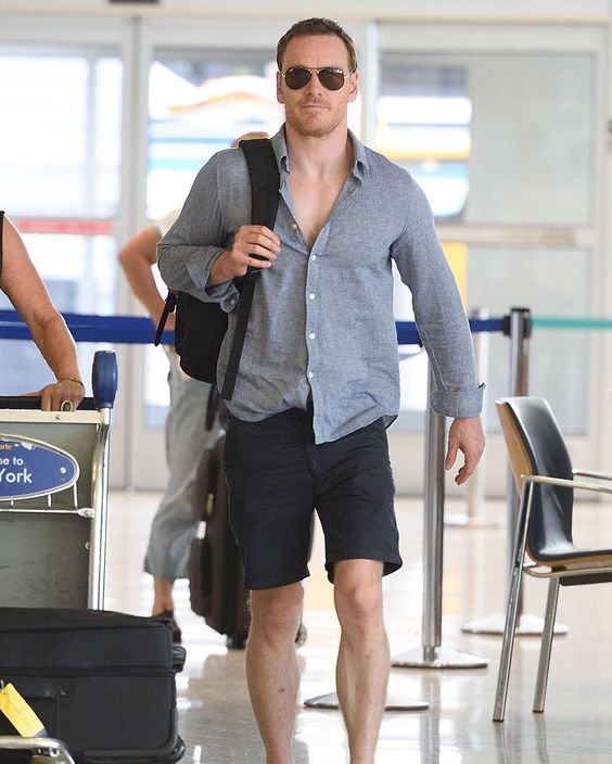 a simple linen shirt and black shorts, a backpack by Michael Fassbender