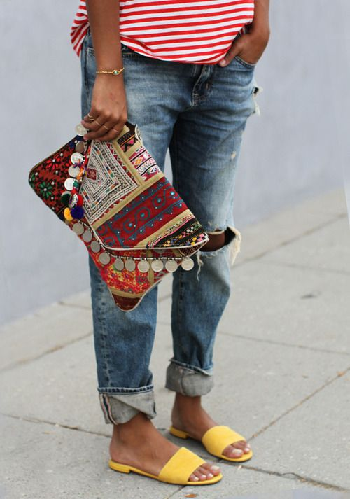 colorful gypsy clutch with pompoms and coins for a relaxed look