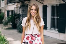 18 a white top and a white midi skirt with a pink floral print, a pink crossbody bag