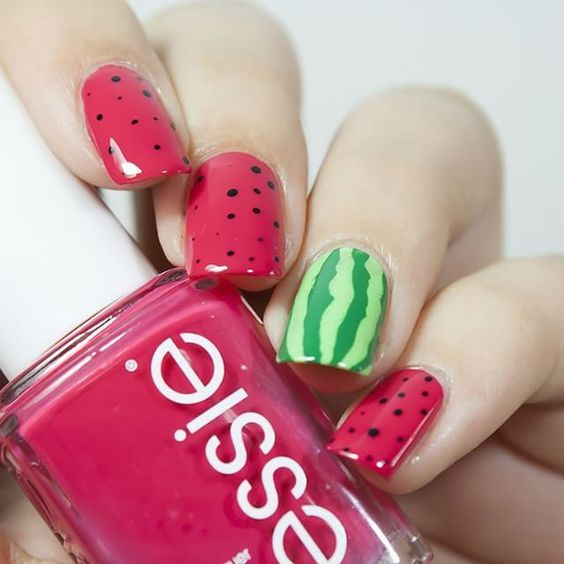 watermelon inspired nails   pink dotted ones and a striped green accent one