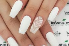 20 white nails and white lace and rhinestone accent ones