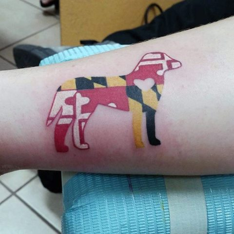 Abstract dog tattoo on the arm