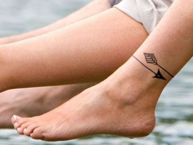 Arrow tattoo on the ankle