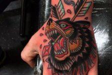 Bear and arrow tattoo on the hand