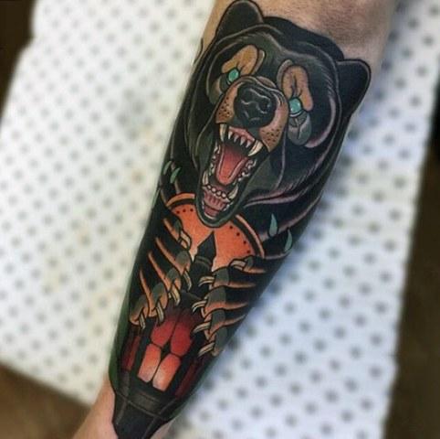 Bear tattoo on the forearm