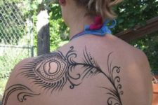 Beautiful tattoo on the back and shoulder