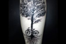 Bicycle and tree tattoo on the leg