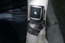 Black computer tattoo on the hand