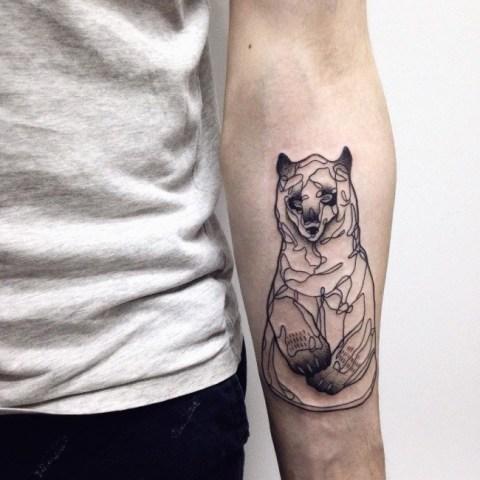 Black-contour tattoo on the forearm