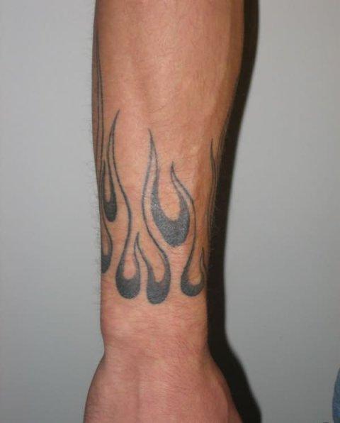Black flame tattoo on the wrist