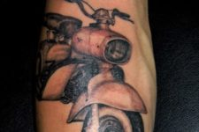 Black, white and red motorcycle tattoo